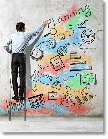 Man drawing a business plan on a wall