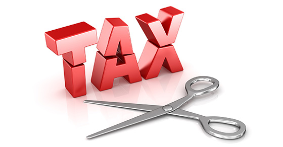 The word TAX and a pair of scissors